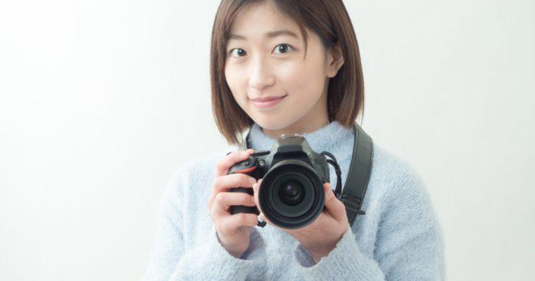 女性カメラマン